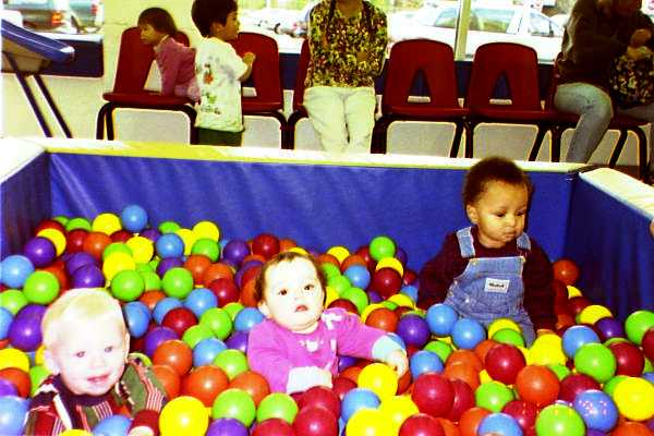 babies in the ball pit